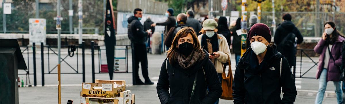 Women with masks walking